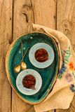 Quince jam in small ceramic plates. Upper view shot of quince jam in small blue ceramic plates on rustic wooden tabletop royalty free stock photos