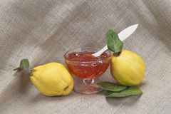 Quince jelly. Still life with quinces and quince jelly in a glass cup Stock Photo