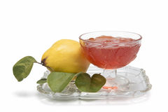 Quince jelly. Still life with quinces and quince jelly in a glass cup Stock Image