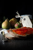 Quince Jelly on Bread Royalty Free Stock Images