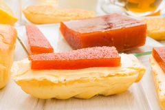 Quince jelly on butter spread Stock Photos
