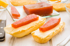 Quince jelly on butter spread Royalty Free Stock Photo
