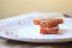 Quince jelly on ceramic plate. Jelly made from quince fruit. Stock Photography