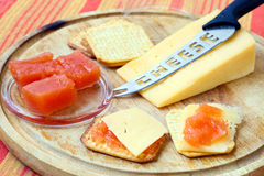 Quince jelly, cheese, crackers Royalty Free Stock Photos