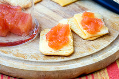 Quince jelly, cheese, crackers Stock Photo