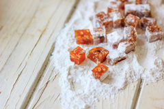 Quince jelly on sugar powder over the table Royalty Free Stock Photos