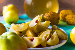 Quince sliced fruit wooden table setting Stock Images