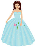 Quinceanera Girl. A Latina girl is ready for her Quinceanera. She wears a blue gown sparkling with diamonds, a tiara and carries a pink rose. Also can be prom or Stock Photos