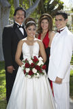 Quinceanera With Parents And Partner Standing In Lawn Royalty Free Stock Photo