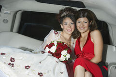 Quinceanera Sitting With Mother In Limousine Royalty Free Stock Photos