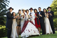 Quinceanera Standing With Family And Friends Royalty Free Stock Images