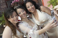 Quinceanera Taking Self Portrait With Friends Stock Photo