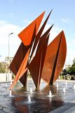 Quincentennial Fountain at Eyre Square, Galway Ireland. Quincentennial Fountain at Eyre Square shows rusty iron plates resembling sails standing in pool. Broader Royalty Free Stock Photography