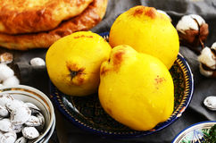 Quinces, flat bread and salty apricot pits in oriental way Stock Photography