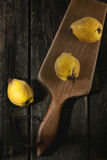 Quinces over wood Royalty Free Stock Photo