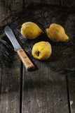 Quinces over wood Royalty Free Stock Photography