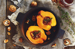 Quinces stewed with honey, walnut and thyme Royalty Free Stock Photos