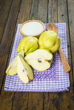 Quinces and sugar on the kitchen table Stock Image