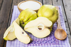 Quinces and sugar on the kitchen table Stock Photography