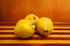 Quinces. Sweet quinces over wooden background Royalty Free Stock Photo