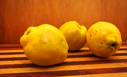 Quinces. Sweet quinces over wooden background Stock Images
