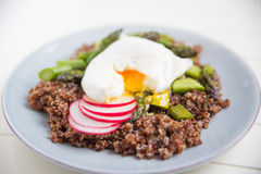 Quinoa with asparagus and poached egg Royalty Free Stock Photography