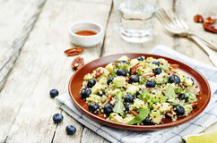 Quinoa avocado blueberry pecan salad with maple syrup lime dress. Ing. toning. selective focus Stock Photos