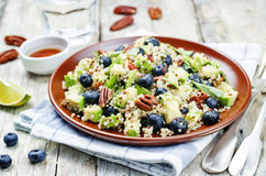 Quinoa avocado blueberry pecan salad with maple syrup lime dress royalty free stock images