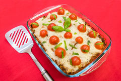 Quinoa bake. With minced meat, tomato sauce and topped with mozzarella and chopped tomatoes stock photos