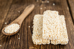 Quinoa Bars. Fresh made Quinoa Bars (selective focus; close-up shot) on an old wooden table Royalty Free Stock Photos