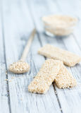 Quinoa Bars. Fresh made Quinoa Bars selective focus; close-up shot on an old wooden table Royalty Free Stock Images