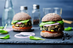 Quinoa black bean spinach corn burgers with black beans bun crus. T. toning. selective Focus Royalty Free Stock Photo