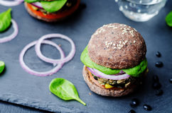 Quinoa black bean spinach corn burgers with black beans bun crus Stock Photography