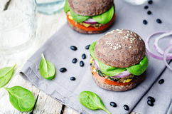Quinoa black bean spinach corn burgers with black beans bun crust. Toning. selective Focus royalty free stock image