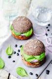 Quinoa black bean spinach corn burgers with black beans bun crus. T. toning. selective Focus Stock Photos