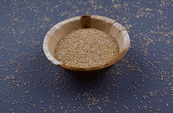 Quinoa in bowl on the dark background. Royalty Free Stock Image