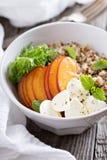 Quinoa bowl with peach and mozarella Stock Image