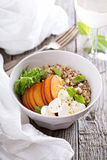 Quinoa bowl with peach and mozarella Royalty Free Stock Images