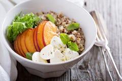 Quinoa bowl with peach and mozarella Royalty Free Stock Photo