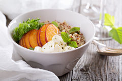 Quinoa bowl with peach and mozarella Royalty Free Stock Photography