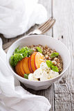Quinoa bowl with peach and mozarella Stock Images