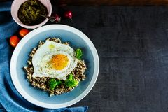 Quinoa, broccoli and egg bowl. Fresh vegetarian breakfast bowl. Quinoa, broccoli and egg over dark concrete background. Healthy breakfast or snack. Energy Royalty Free Stock Photography