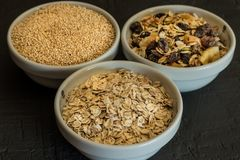 Quinoa, brown rice and oats. Healthy whole grain cereals. Vegan food concept. Quinoa, brown rice and oats. Healthy whole grain cereals. Concept Vegan food and royalty free stock photography