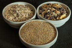 Quinoa, brown rice and oats. Healthy whole grain cereals. Vegan food concept. Quinoa, brown rice and oats. Healthy whole grain cereals. Concept Vegan food and stock images