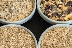Quinoa, brown rice and oats. Healthy whole grain cereals. Vegan food concept. Quinoa, brown rice and oats. Healthy whole grain cereals. Concept Vegan food and stock photography