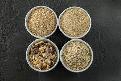 Quinoa, brown rice, seeds and oats . Whole grain and organic food concept for vegetarians. Quinoa, brown rice, seeds and oats in a bowl. Whole grain and organic royalty free stock photo