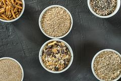 Quinoa, brown rice, seeds and oats . Whole grain and organic food concept for vegetarians. Quinoa, brown rice, seeds and oats in a bowl. Whole grain and organic royalty free stock image