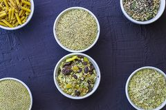 Quinoa, brown rice, seeds and oats . Whole grain and organic food concept for vegetarians. Quinoa, brown rice, seeds and oats in a bowl. Whole grain and organic stock photos