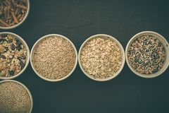 Quinoa, brown rice, seeds and oats . Whole grain and organic food concept for vegetarians. Quinoa, brown rice, seeds and oats in a bowl. Whole grain and organic stock photo