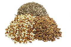 Quinoa chia and flax seeds isolated on white background stock photos